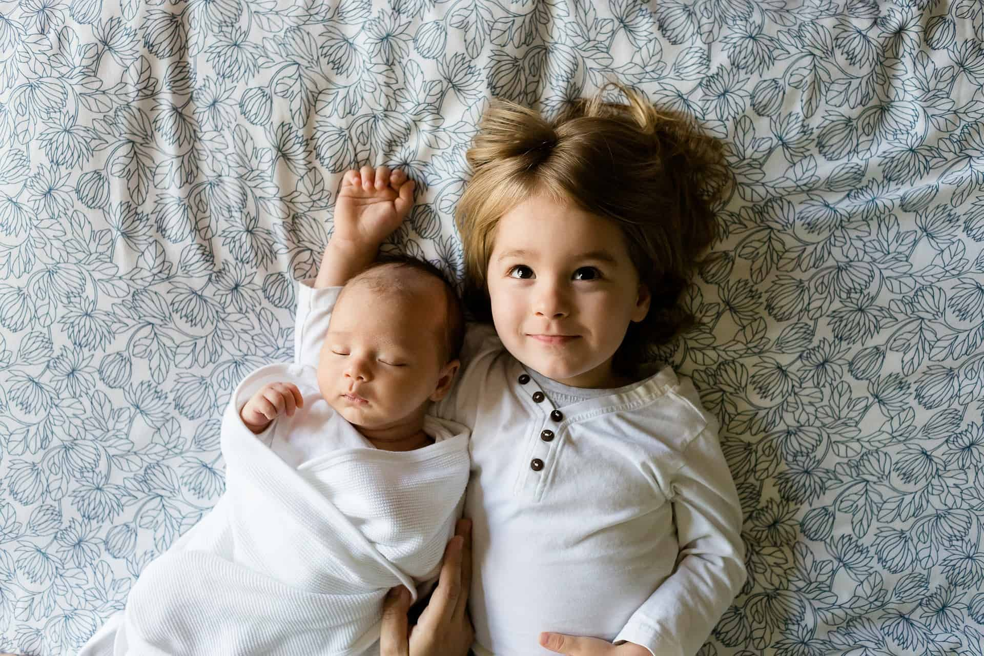 a girl with her baby brother/sister