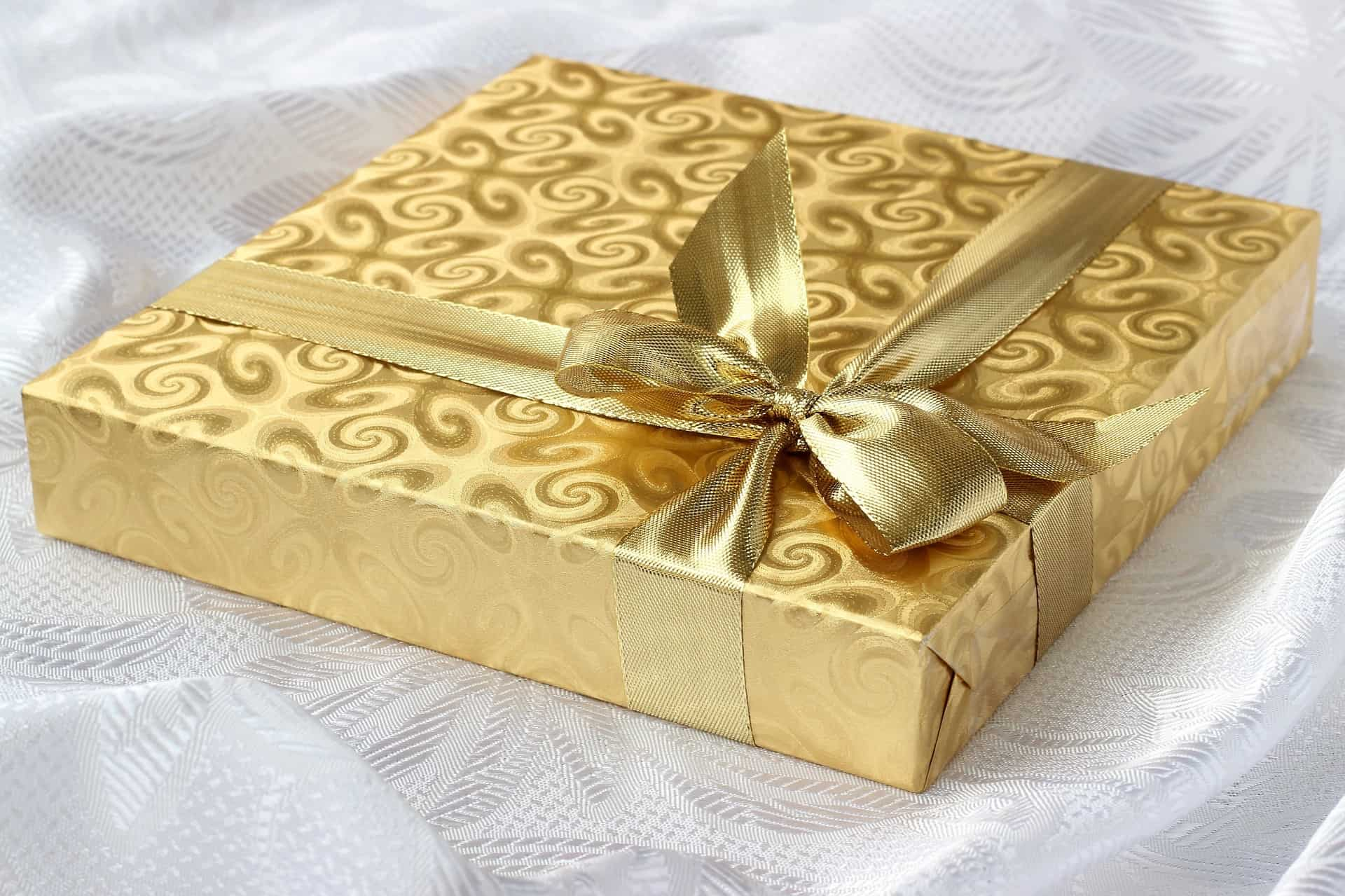 a gift wrapped with a golden paper
