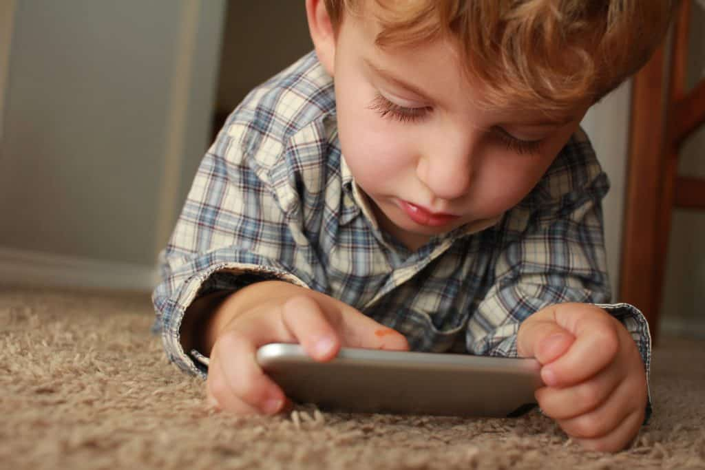 a boy play with his gadget