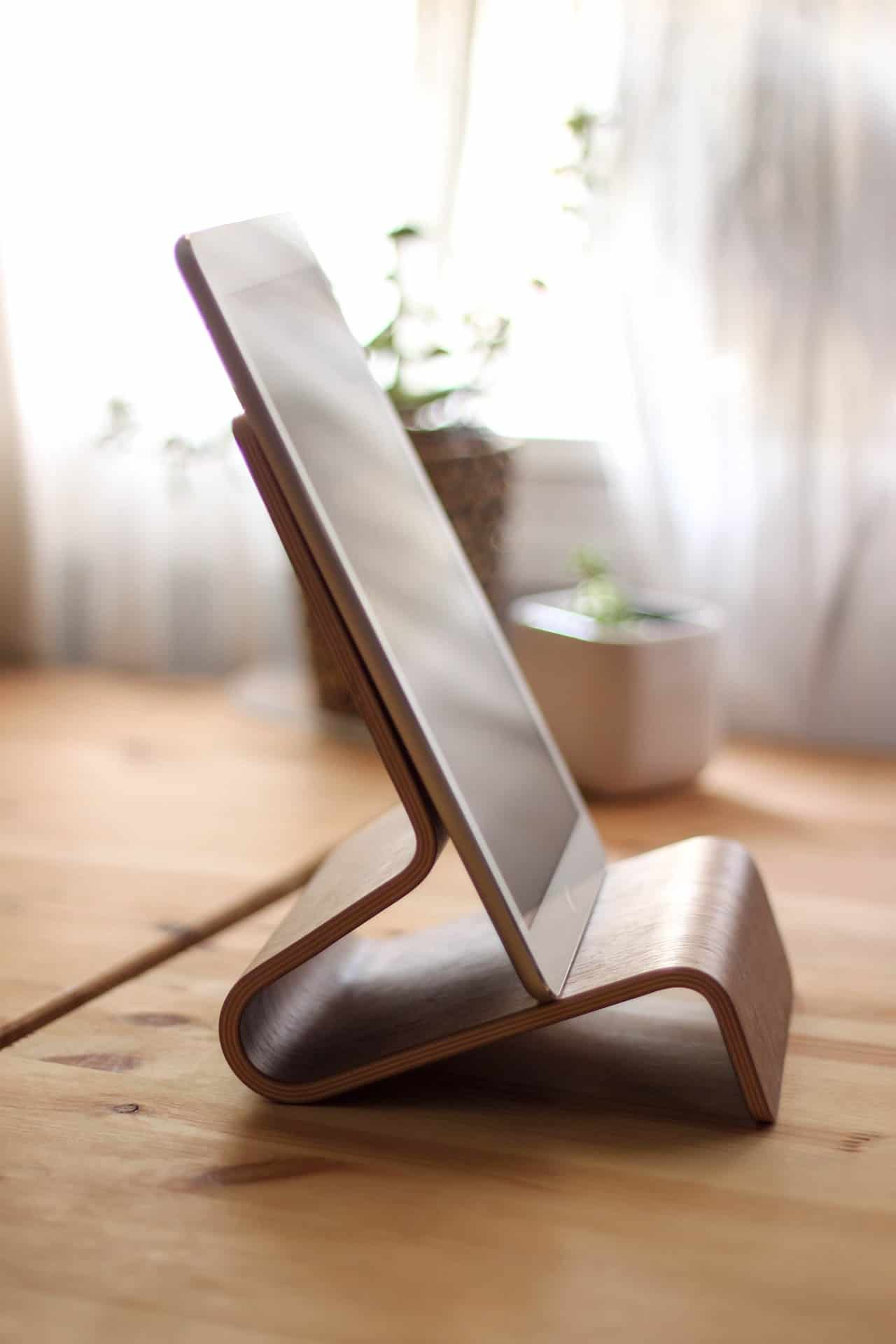 a wooden tablet holder