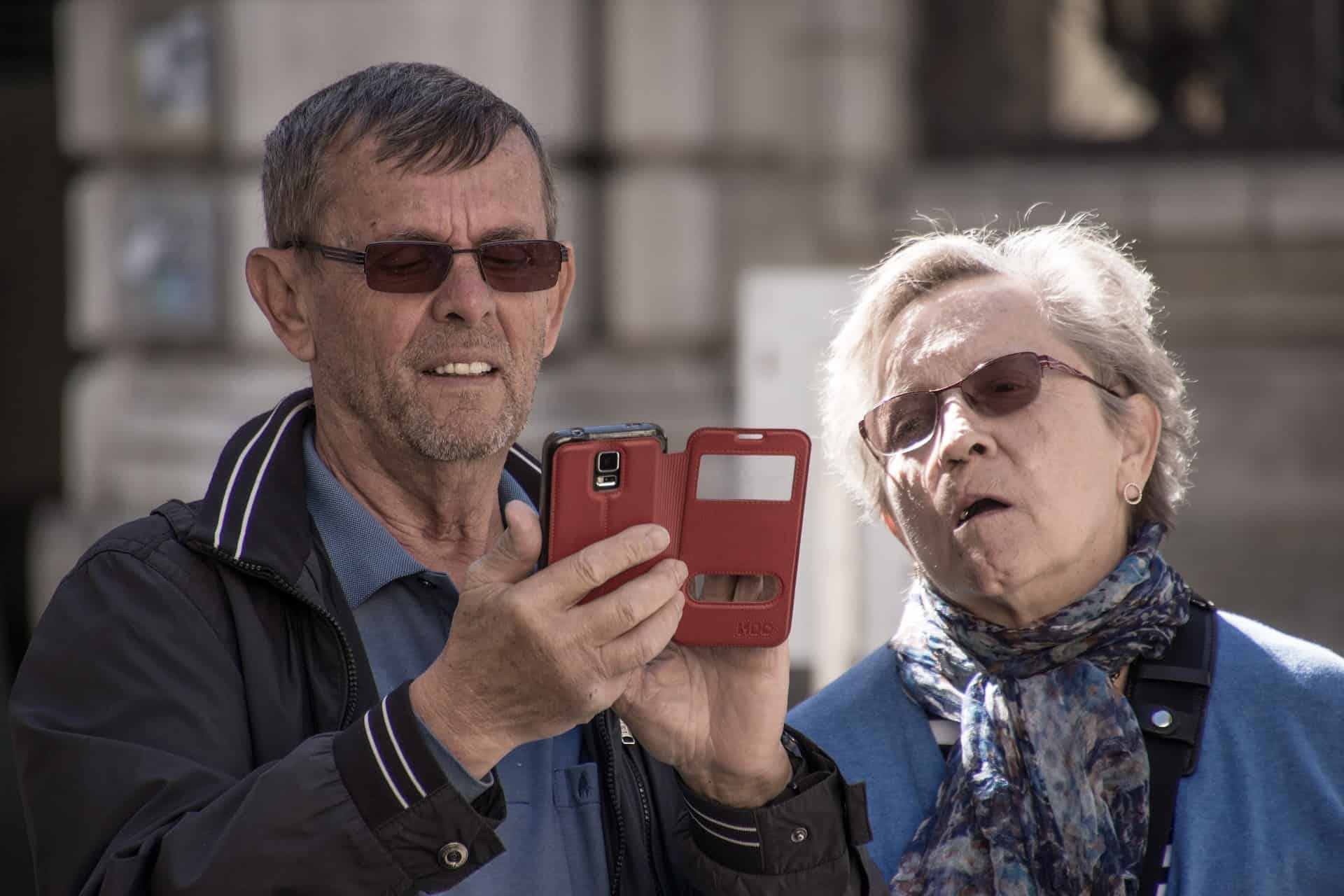 an old people is using his phone