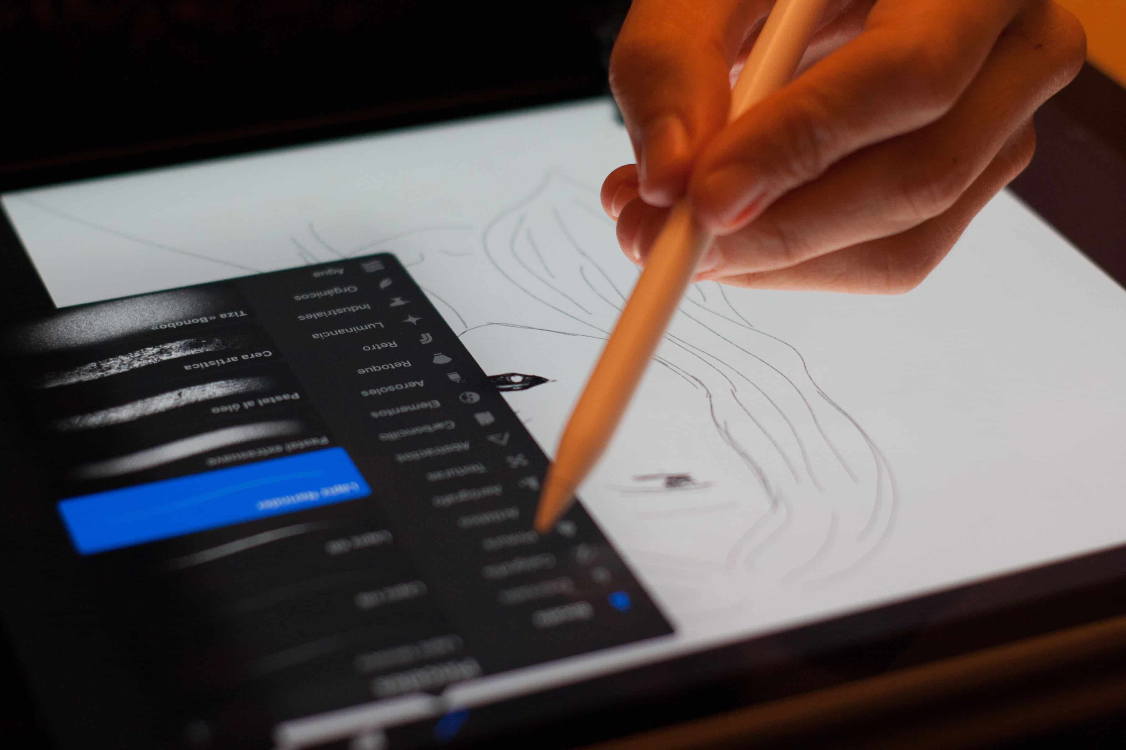 someone is drawing with a drawing app with a tablet