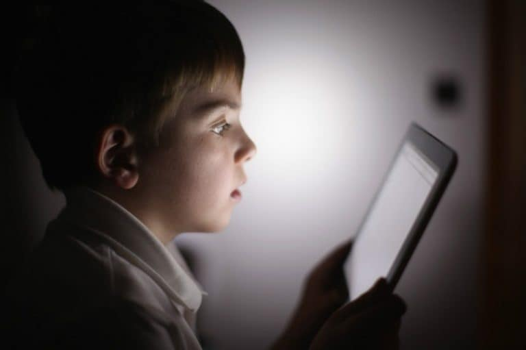 Child staring at screen
