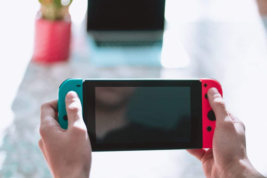 person holding nintendo switch