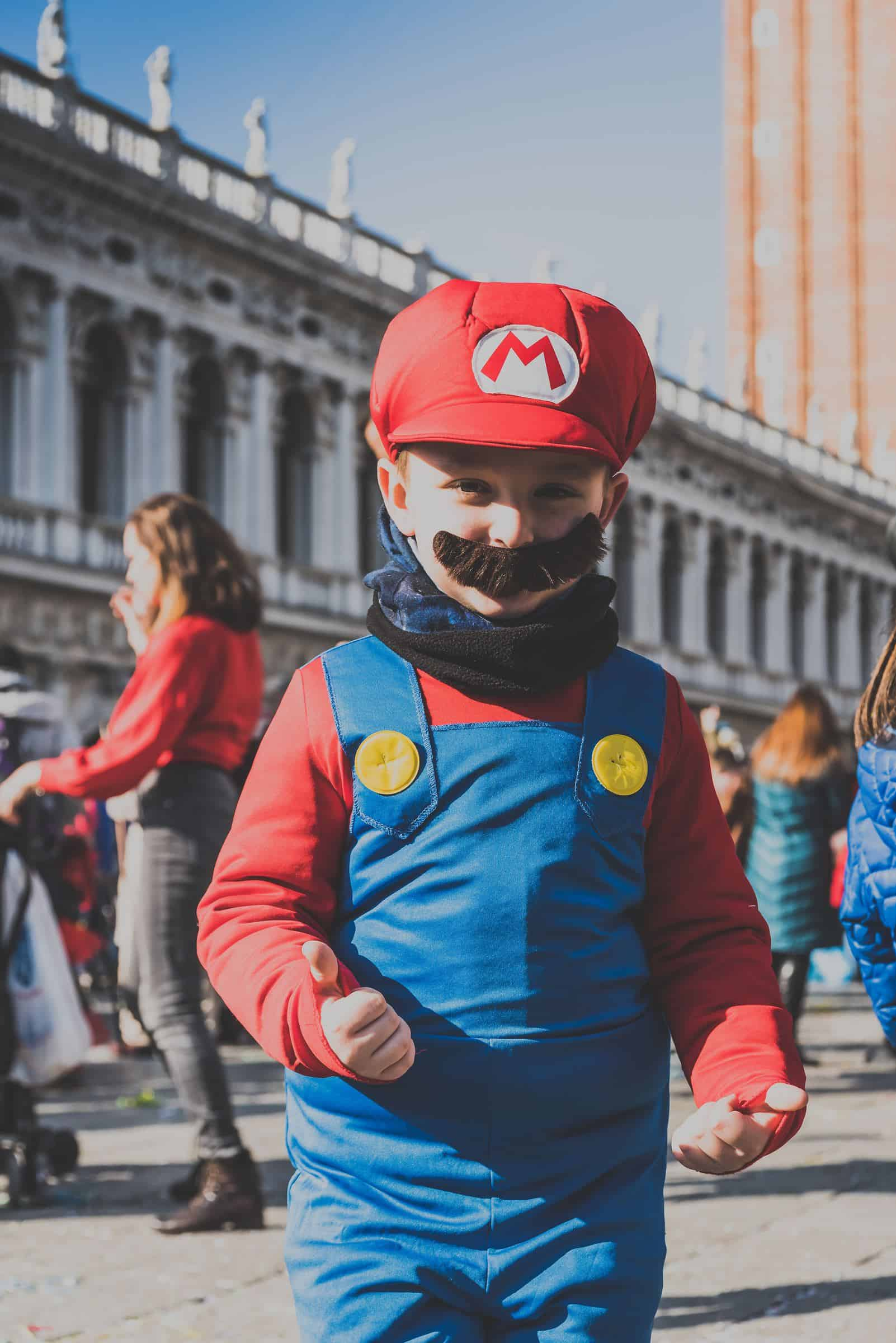 boy wearing Super Mario costume
